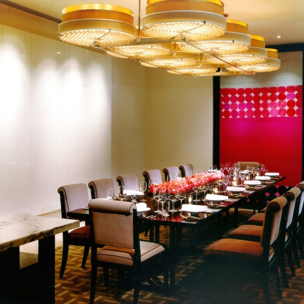 Nomi at park hyatt studiogronda in turn leads to the dining room which boasts italian tile floors leather padded support beams and dale chihuly chandeliers while offering stunning dzzzfo